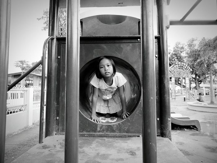 Portrait Of Girl Playing In Jungle Gym At Playground