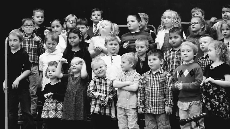 Visual Journal December 2016 Meridian School Daykin, Nebraska (Fujifilm Xt1, Fujifilm XC 50-230mm F4.5-6.7 OIS) edited with Google Photos. B&w Photography Black & White Camera Work Childhood Childhood Memories Children Children Only Choir  Chorus Christmas Pageant Classmates Crowd Elementary Age Elementary School Group Of People Kids Kids Being Kids Music Photo Diary Real People Rural America School Singing Small Town Stories Visual Journal