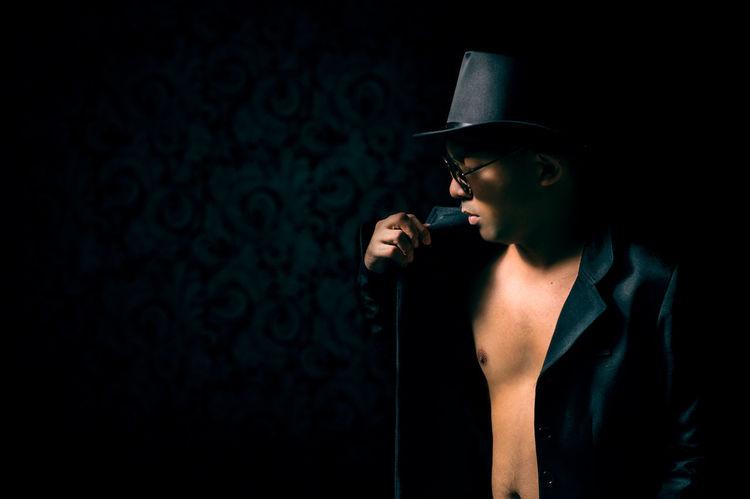 Man in Black with Hat Asian  Black Background Black Suit Dark Dark Background Hat Indoors  Male Malemodel  Men One Person People Shades Shirtless Shirtlessguys Skin Studio Shot Young Adult