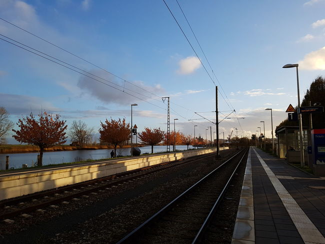 Railroad Track Transportation Sky Electricity  Cloud - Sky Rail Transportation No People Mode Of Transport Outdoors Technology Day No Filter, No Edit, Just Photography Light Autumn Colors Autumappreciation Trainstation Railway Autumnvibes  Fall Autumn Cold But Beautiful Cold But Sunny