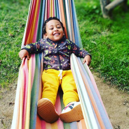 Portrait of smiling boy relaxing on hammock