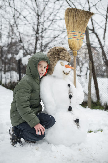 Snow Snowman Snowman⛄ Making Winter Cold Temperature Cold Play Playng Child Boy Warm Clothing One Person Leisure Activity Full Length Nature Childhood Clothing White Color Day Real People Tree Portrait Outdoors