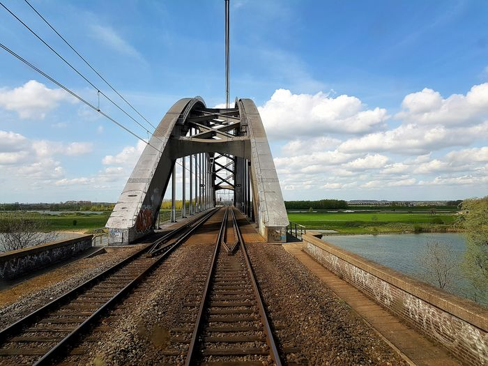 Nature See What I See Sky And Clouds The Netherlands View Architecture Bridge Bridge - Man Made Structure Bridge View Built Structure Cable Cloud - Sky Connection Day Landscape Nature No People Outdoors Rail Transportation Railroad Track Sky The Way Forward Transportation View From The Train Water