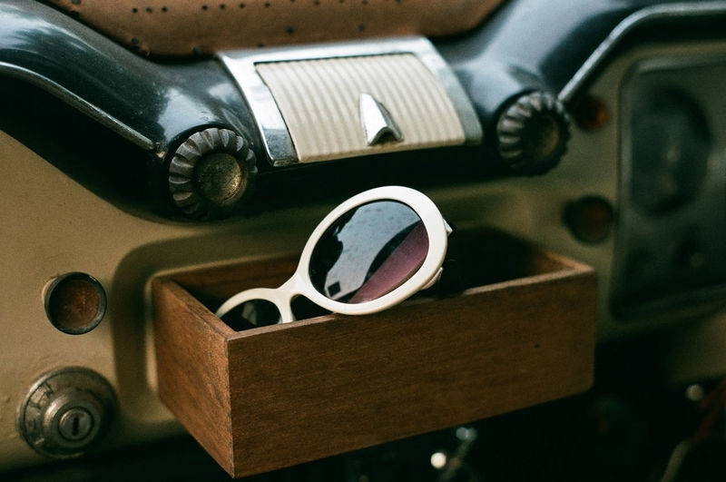 Sunglass on vintage car. Retro Styled Close-up Vehicle Interior Car Interior Mode Of Transportation Car Transportation No People Indoors  Motor Vehicle Land Vehicle Antique Dashboard Metal Old Vintage Car Steering Wheel Selective Focus Number Silver Colored Vintage 50s 60s 70s 80s