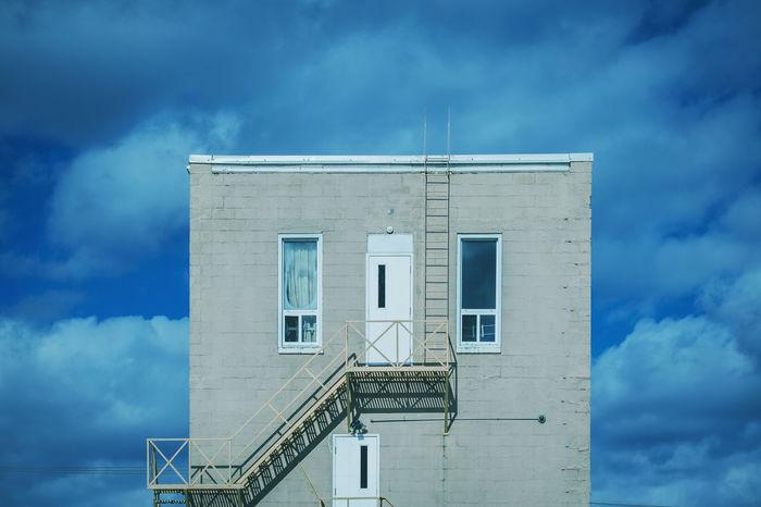 Architecture Blue Building Built Structure Cloud Cloud - Sky Cloudy Day Fireescape Outdoors Sky Weather Minimalist Architecture