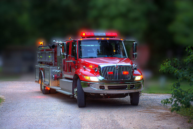 Close-up of fire engine on road