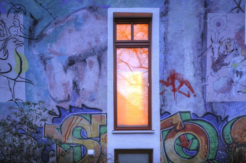 Old House Walll and Window with Graffiti at Dusk in Ostertor-Quarter, Bremen, Germany, europe Architecture Bremen Building Exterior Built Structure Close-up Dusk Evening Hanging Out Hausmann Hauswand Illuminated Low Angle View No People Outdoors Viertel Window