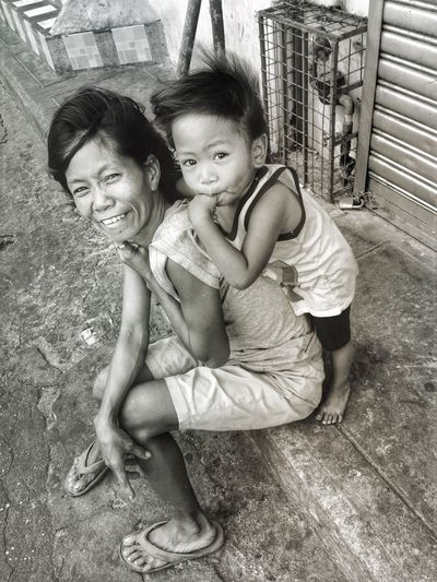 Portrait of mother and girl sitting on floor