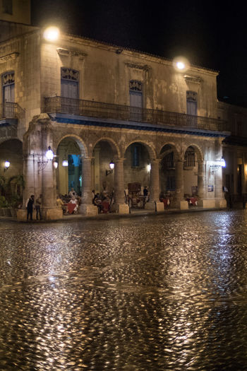Around the Cathedral Place by night and rainy weather Cobblestone Cuba Cuba Collection Habana Vieja Illuminated Night Nightshot Plaza De Catedral Rain Reflections Restored Building Travel Destinations Travel Photography Unrecognizable People We