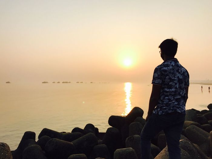 Sunset Real People Sea Beauty In Nature Rear View Water Lifestyles Men One Person Sky Nature Horizon Over Water Leisure Activity Beach Tranquility Scenics Sun Outdoors Day Adult