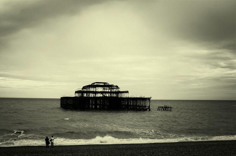 Dilapidated West Pier Against Cloudy Sky