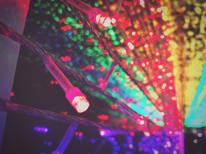 Low angle view of multi colored lights