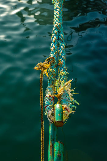 Close-Up Of Rope In Hook Over River