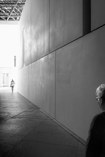 Rear view of man walking on wall
