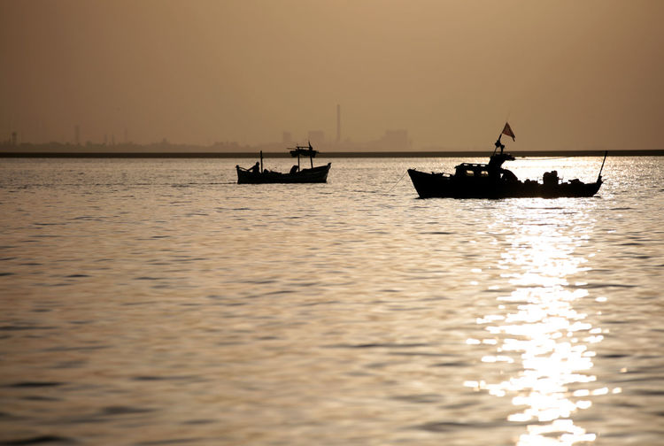 one morning in the sea Beauty In Nature Fisherman Fishing Boat Mode Of Transportation Nature Nautical Vessel Orange Color Outdoors Reflection Sailing Scenics - Nature Sea Silhouette Sky Sunset Tranquil Scene Tranquility Transportation Travel Water Waterfront