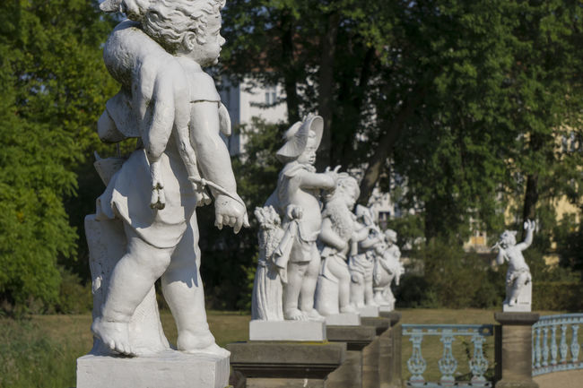 Row of small white child statues at Charlottenburg Palace garden in Berlin, Germany Berlin Charlottenburg Palace Child Color Image Day Garden Germany🇩🇪 Horizontal Human Representation No People Outdoors Park Photography Row Sculpture Spirituality Statue Statues Tree Trees White