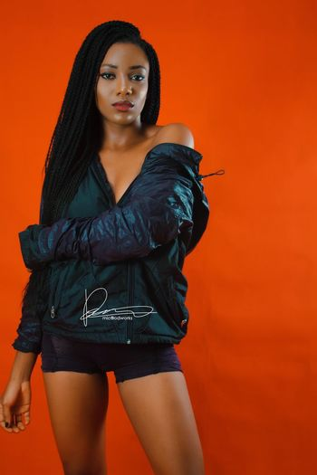 Prime Looking At Camera Portrait Fashion Model Colored Background Studio Shot Three Quarter Length Beauty Beautiful Woman Fashion Beautiful People One Person Arts Culture And Entertainment Glamour Black Hair Standing Posing Indoors  Day