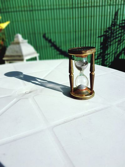 Close-up of hour glass on table