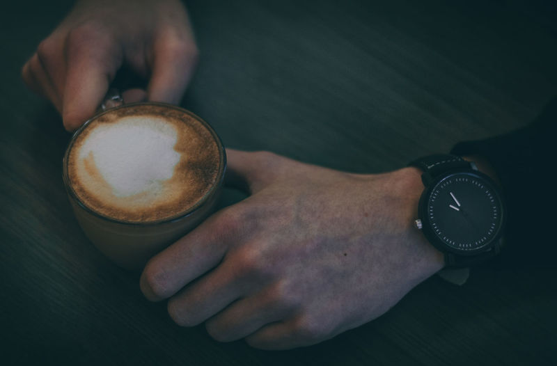 Cappuccino Close-up Coffee - Drink Coffee Cup Day Drink Food And Drink Freshness Froth Art Frothy Drink High Angle View Holding Human Body Part Human Hand Indoors  Men One Person People Real People Refreshment Style Table Time Watch Wristwatch