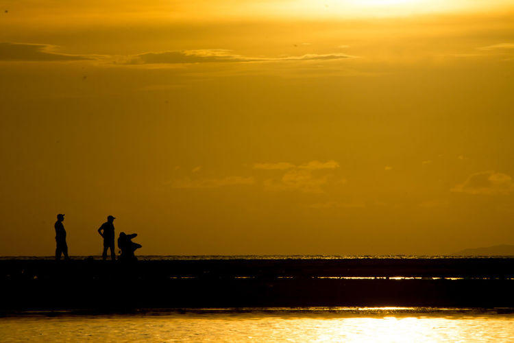 Connected By Travel Horizon Over Water Nature Orange Color Outdoors People Real People Scenics Sea Silhouette Sky Sunset Water