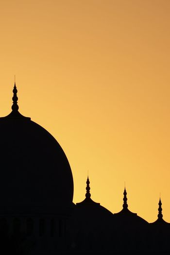 Silhouette mosque against sky during sunset
