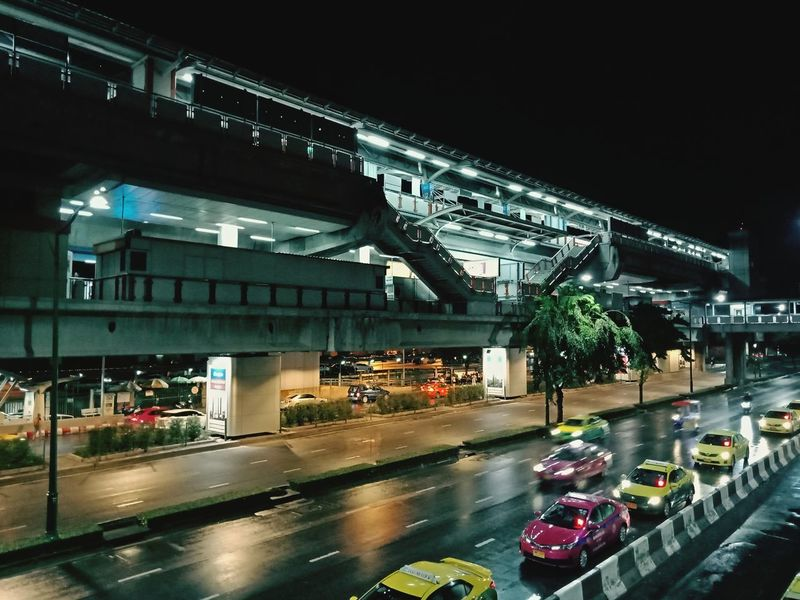 Illuminated City Water Bridge - Man Made Structure Architecture Sky Built Structure Building Exterior Rainy Season Wet Moving Car Parking Car Interior Windshield Rainfall Rain Umbrella Drop Puddle Dew Monsoon Side-view Mirror Vehicle Land Vehicle RainDrop Road Marking