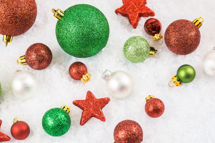 Christmas Christmas Balls December Glitter & Sparkle Green Winter Christmas Bauble Christmas Decoration Close-up Decoration Green Color Indoors  Multi Colored No People Red Season  Snow Stars Variation View From Above White Background
