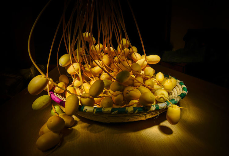 dates with light paint Compsition Date Light Nature Banana Bowl Bunch Choice Close-up Food Food And Drink Freshness Fruit Grape Healthy Eating Indoors  Large Group Of Objects No People Qatar Studio Shot Table Vegetable Wellbeing Wood - Material Yellow