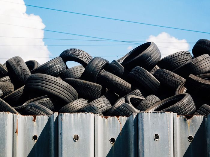 Day No People Large Group Of Objects Cable Sky Sunlight Container Stack Built Structure Architecture Nature Outdoors Transportation Close-up Abundance Side By Side Rope Focus On Foreground Building Exterior Tire Recycling Recycling Center Vehicle Part