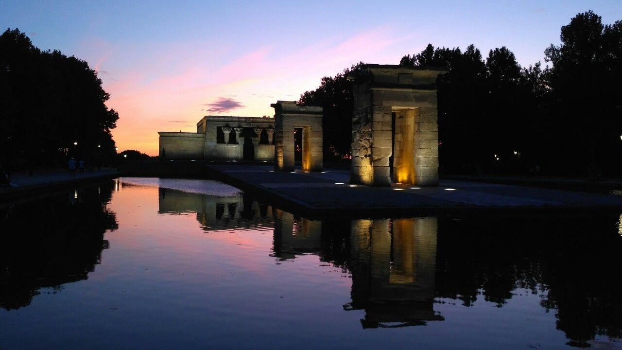 reflection, built structure, architecture, water, sunset, building exterior, tree, sky, history, architectural column, outdoors, waterfront, no people, nature, ancient civilization, day