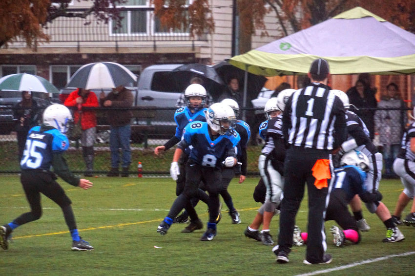 Junior football at Minoru Park in Richmond B.C. Canada. Real People People Headwear Competitive Sport Sports Clothing Canada. Sport Canada B.C Richmond BC Junior Football Playing Field Athlete Grass