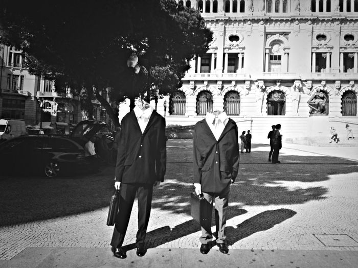 Digital Composite Image Of Businessmen Standing On Sidewalk With People In Background