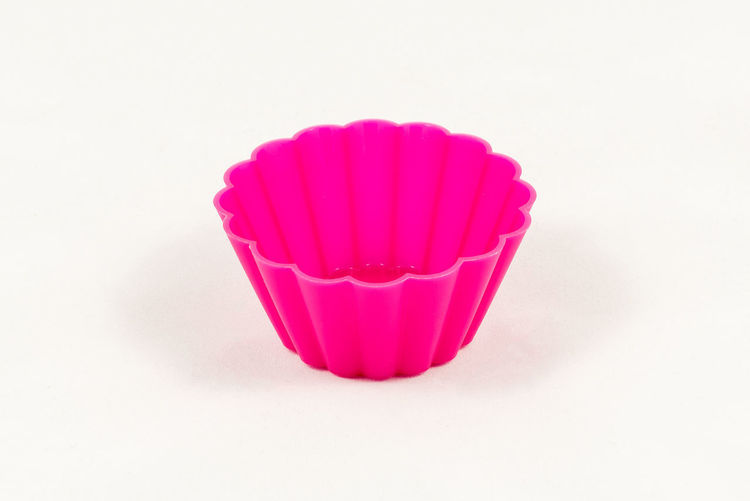 Pink silicone cake cups isolated on white background Cake Close-up Copy Space Cupcake Cupcake Holder Food Food And Drink Freshness Indoors  Indulgence No People Pink Color Red Single Object Still Life Studio Shot Sweet Sweet Food Temptation Unhealthy Eating White Background