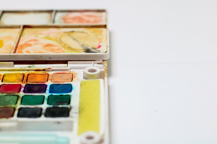 Indoors  Variation Choice Multi Colored Still Life No People Copy Space Brush Paintbrush Close-up Art And Craft Watercolor Paints Studio Shot Palette Table High Angle View Container In A Row White Background Box Box - Container Art And Craft Equipment