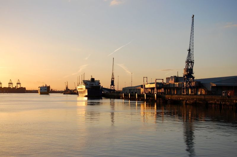 Red Sunset over Southampton Docks in UK, ENGLAND. Calm Cloud Harbor Mode Of Transport Nature Nautical Vessel No People Outdoors Scenics Sea Ship Sky Southampton Southampton Docks Spire  Sun Sunset Tall Tourism Tranquil Scene Tranquility Transportation Vapor Trail Water Waterfront