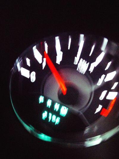 Close-up of illuminated text on car windshield