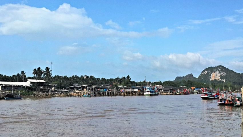 Lang Suan river Beauty In Nature Boat Cloudy Fishing Boat Nature Pak Nam Lang Suan River Sky Thailand Waterfront