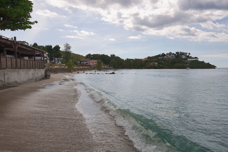 Anse Mitan - Martinique - Caribbean island Anse Antilles Architecture Beach Beauty In Nature Building Exterior Built Structure Caribbean Caribbean Sea Cloud - Sky Island Martinique Mitan Nature Sand Scenics Sea Shoreline Sky Tranquil Scene Tranquility Tree Tropical Water Wave