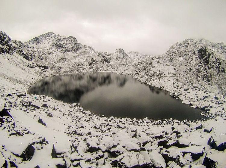View of Gosaikunda Lake after snowfall, Rasuwa, Nepal. Gosaikunda lake is at the height of 4380Meter above the sea level. Nepal Trekking In Nepal Trekking In Himalayas Landscape Canonphotography GoPro Hero3+ Goprophotography EyeEmNewHere Gopro Shots Snow ❄ Langtang