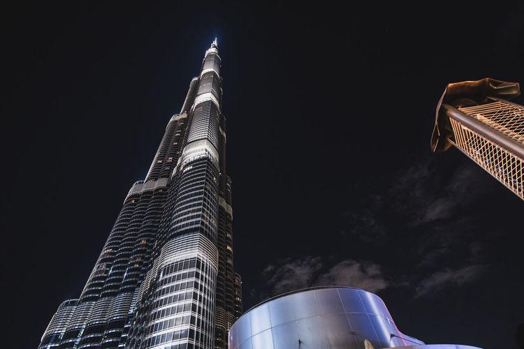 Tower Low Angle View Building Exterior Tourism Outdoors City Travel Destinations Modern No People Illuminated Building Tall - High Skyscraper Sky Night Architecture Dubai Dubai Burj Khalifa Burj Khalifa Glass - Material
