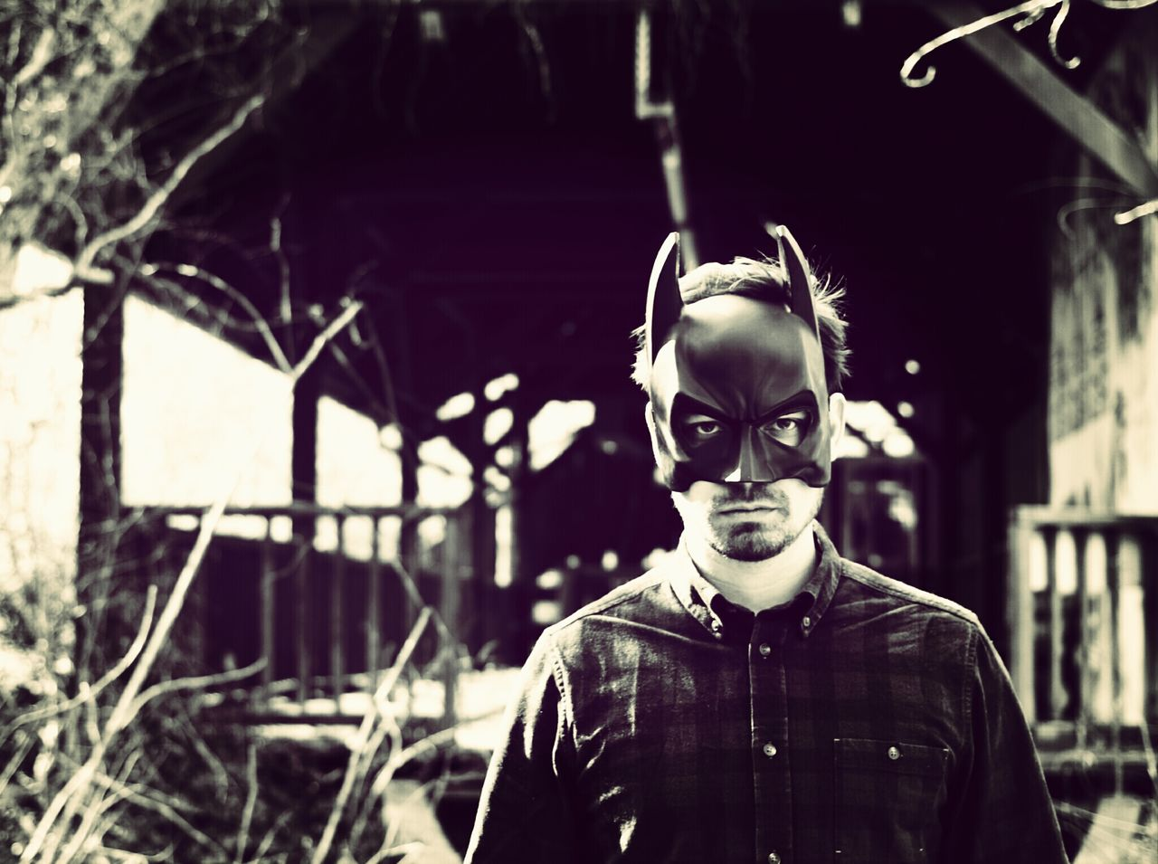 Portrait of man in batman mask