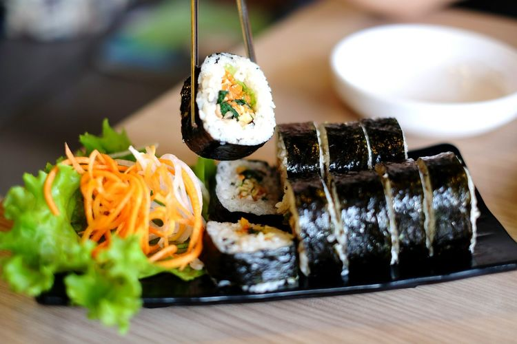 High angle view of sushi in plate on wooden table