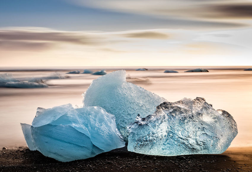 Three icebergs near Jokulsarlon Glacier Lagoon in Southern Iceland. Atlantic Ocean Iceland Beach Beauty In Nature Cold Temperature Environment Frozen Glacier Ice Iceberg Iceberg - Ice Formation Land Melting Nature No People Outdoors Scenics - Nature Sea Sky Smoothie Snow Tranquil Scene Tranquility Water Winter