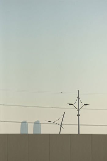 Low angle view of wind turbine against clear sky