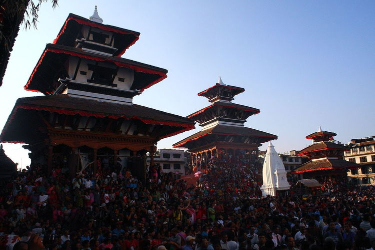 People watching Indra Jatra at Basantapur Durbar Square Architecture Basantapur Durbar Square Community Crowd Cultures History IndraJatra Low Angle View People Watching Place Of Worship Religion Spirituality Temple - Building Carnival Crowds And Details