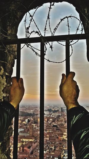 Da qui... voglio uscire Human Hand Men Real People Outdoors Sky Built Structure Human Body Part Architecture One Person Day Close-up City Nature Only Men People Prisoners Prison Torredegliasinelli