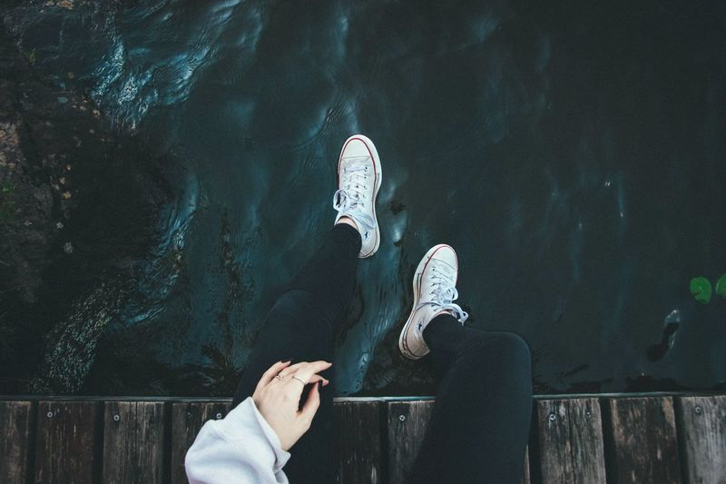 🌊🌊 Travel Grunge River Converse Water One Person Human Body Part Personal Perspective Low Section Human Leg Lifestyles Real People Unrecognizable Person Body Part Communication Holding Shoe Nature