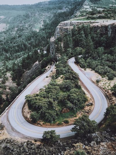 Beauty In Nature Curve Day High Angle View Mountain Mountain Road Nature No People Outdoors Road The Way Forward Tranquility Transportation Tree Water Winding Road Fresh On Market 2018