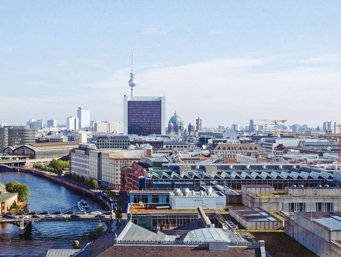 Distant View Of Fernsehturm Amidst Cityscape