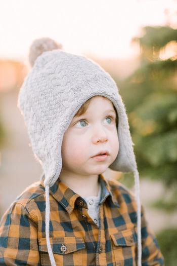 Portrait of boy wearing hat during winter